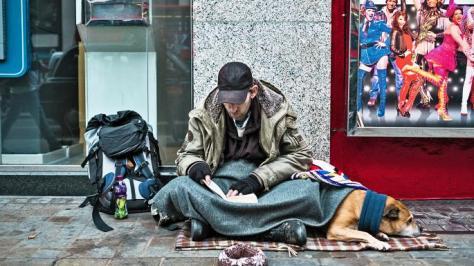 Homeless man on sidewalk