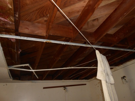 Kaipaka ceiling tiles removed laundry hung