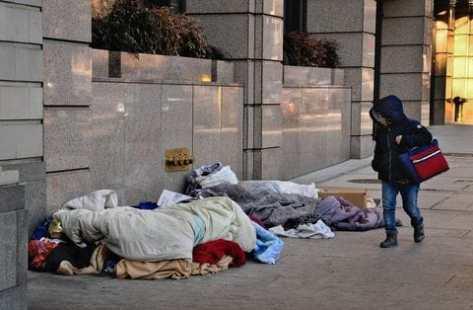 HOmeless sleeping on sidewalk