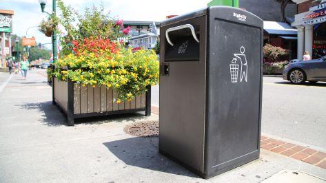City trash can on sidewalk
