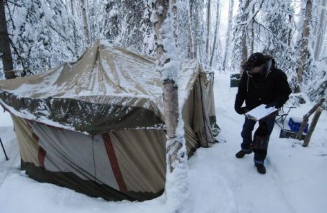 Tent and man in snow